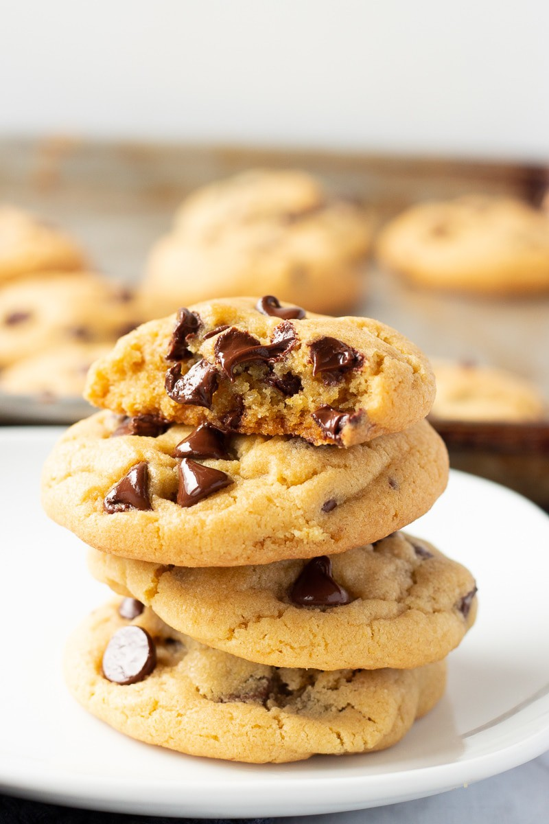 Baked stack of 4 chocolate chip pudding cookies.