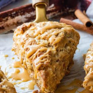 Baked Apple Cinnamon Scone on spatula with maple glaze