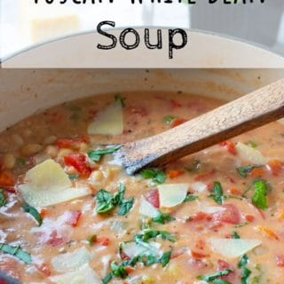 Large pot of Cooked Tuscan White Bean Soup with text overlay.