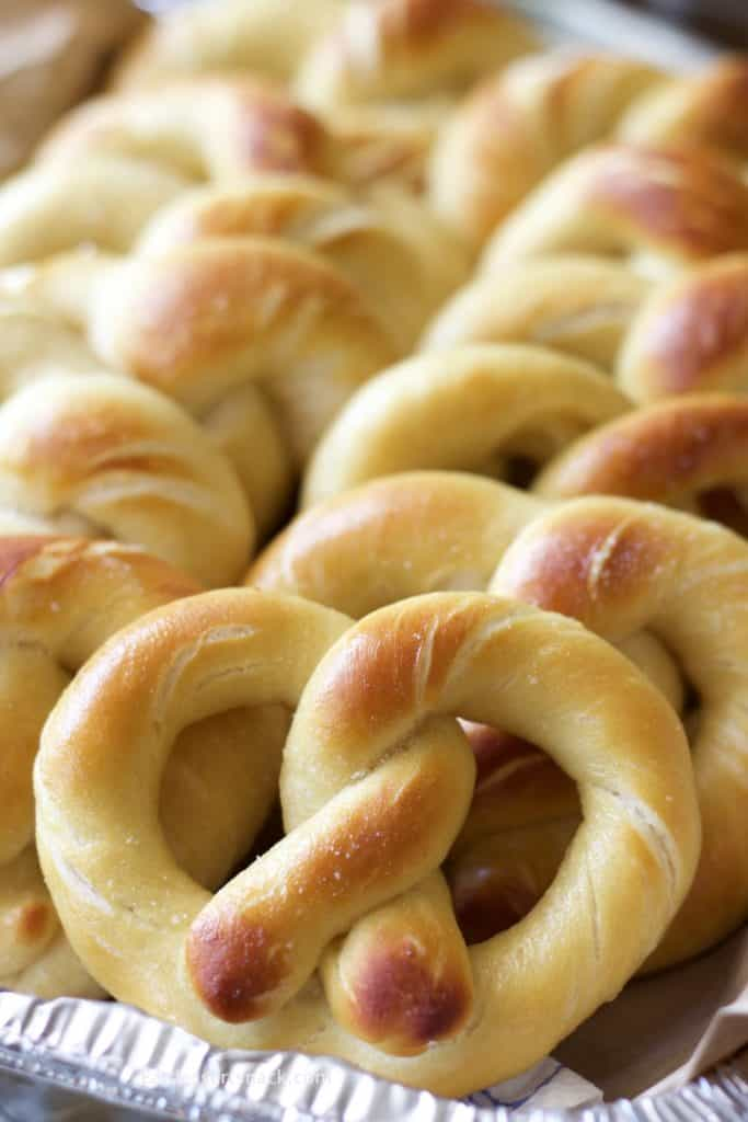 Baked Pretzels in a pan with salt.