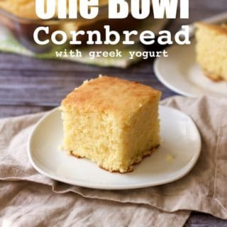 Baked Sweet Cornbread square sliced on a white plate.