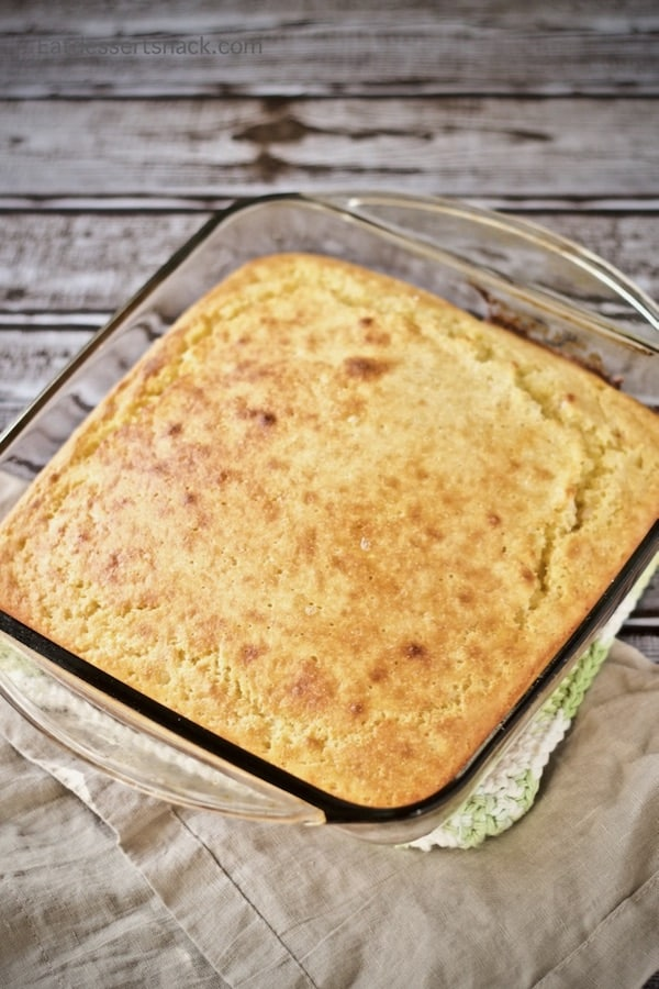 Sweet Corn Bread Baked in a glass square pan.