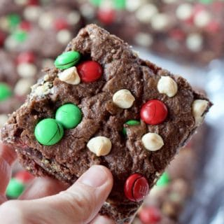 Baked Double Chocolate Cookie Bar hand holding slice