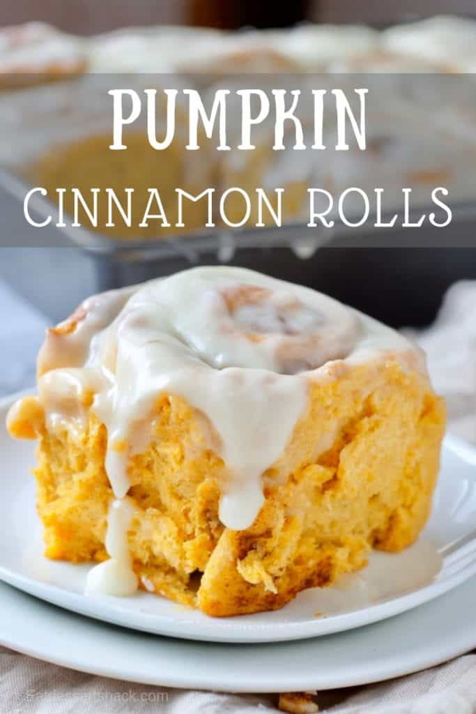 Pumpkin Cinnamon Roll on a white plate, dark pan behind. Text overlay on photo.