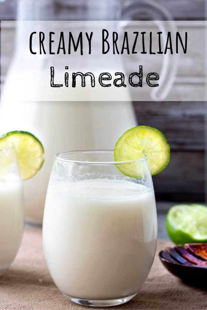 Brazilian Limeade in a glass cup in front of a pitcher. Text Overlay