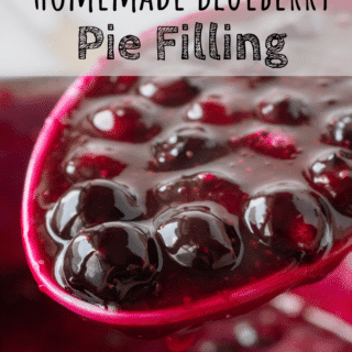 A spoonful of cooked blueberry pie filling.