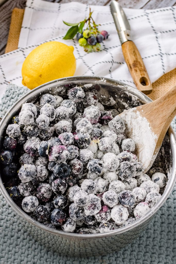 Raw ingredients of blueberry pie filling in a pot.