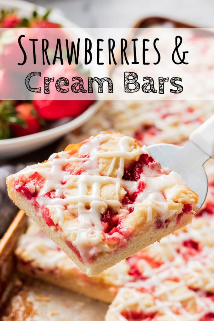 Slice of baked Strawberries and cream bars above pan and strawberries.
