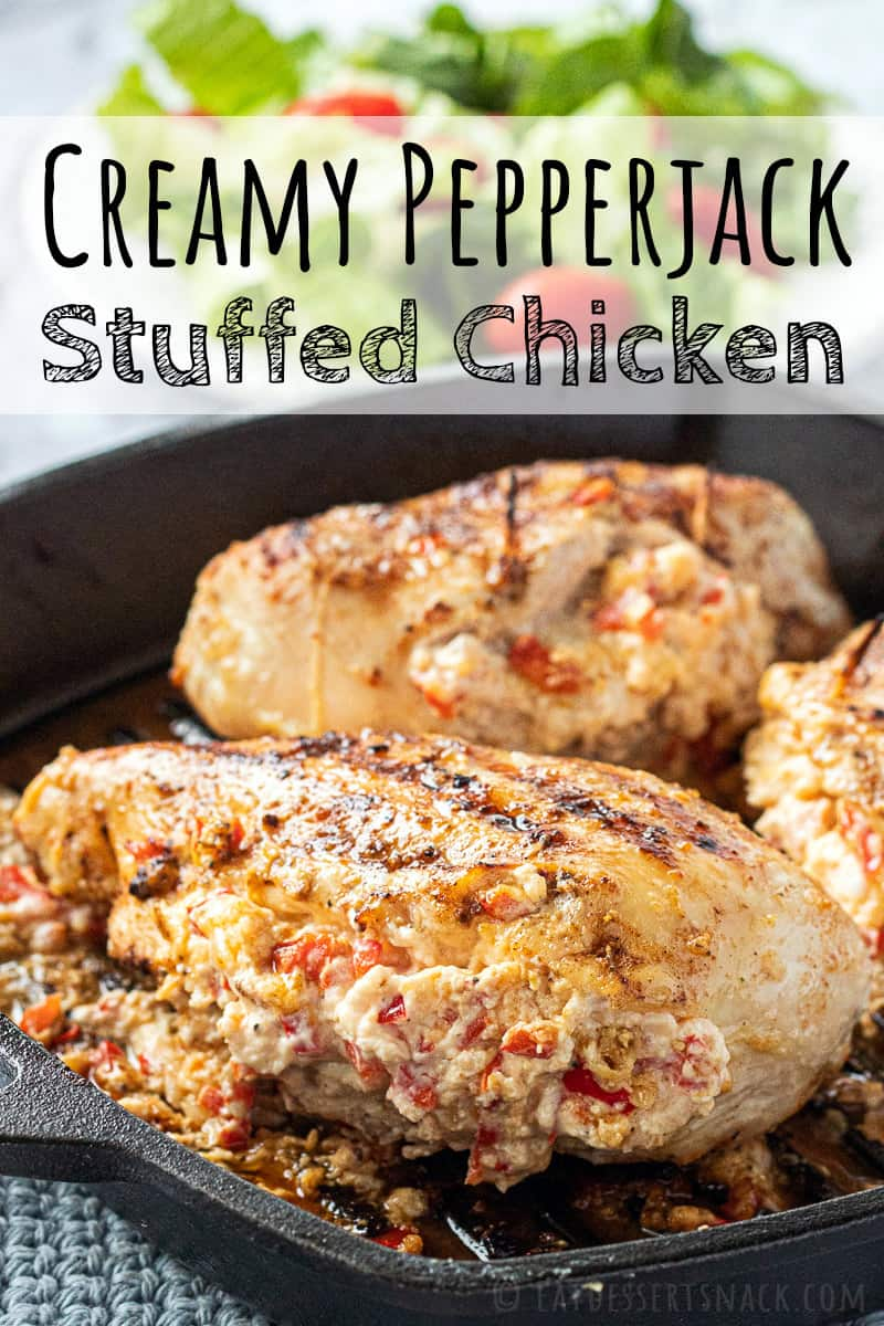 Baked Cheesy Stuffed Chicken Breast in black cast iron pan.