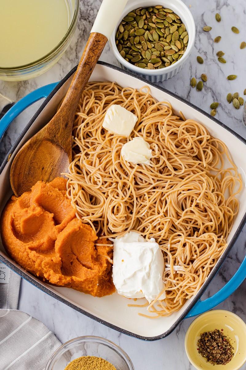 Pumpkin Pasta ingredients, butter, puree, wooden spoon, cream cheese.