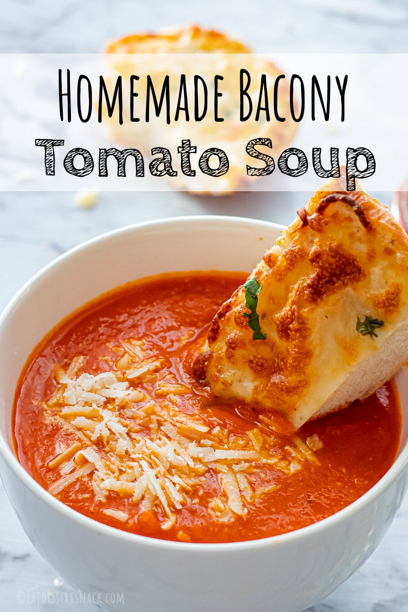 Cooked homemade tomato soup with cheesy bread and parmesan cheese