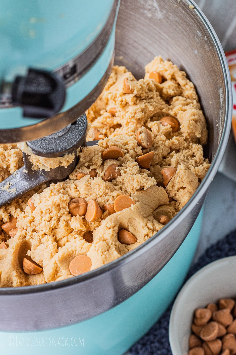 Raw Butterscotch cookie dough in blue mixer.