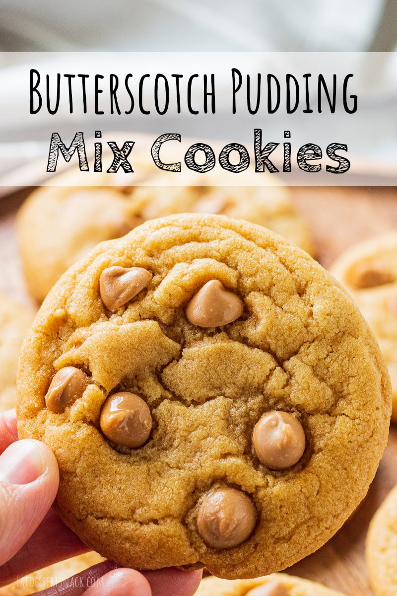 hand holding baked butterscotch chip cookie with text overlay