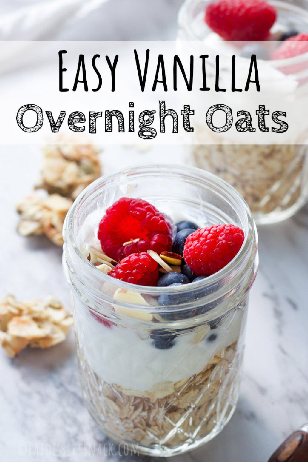 easy overnight oats with raspberries and blueberries in a mason jar on marble countertop with text overlay.