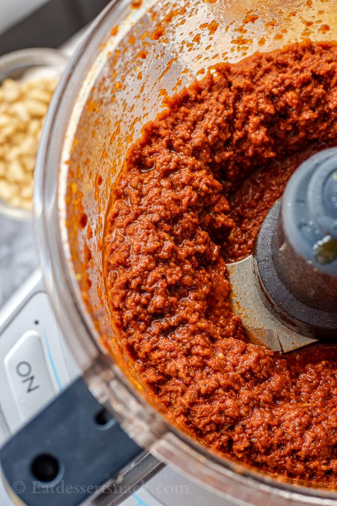 Blended red pesto sauce in food processor.